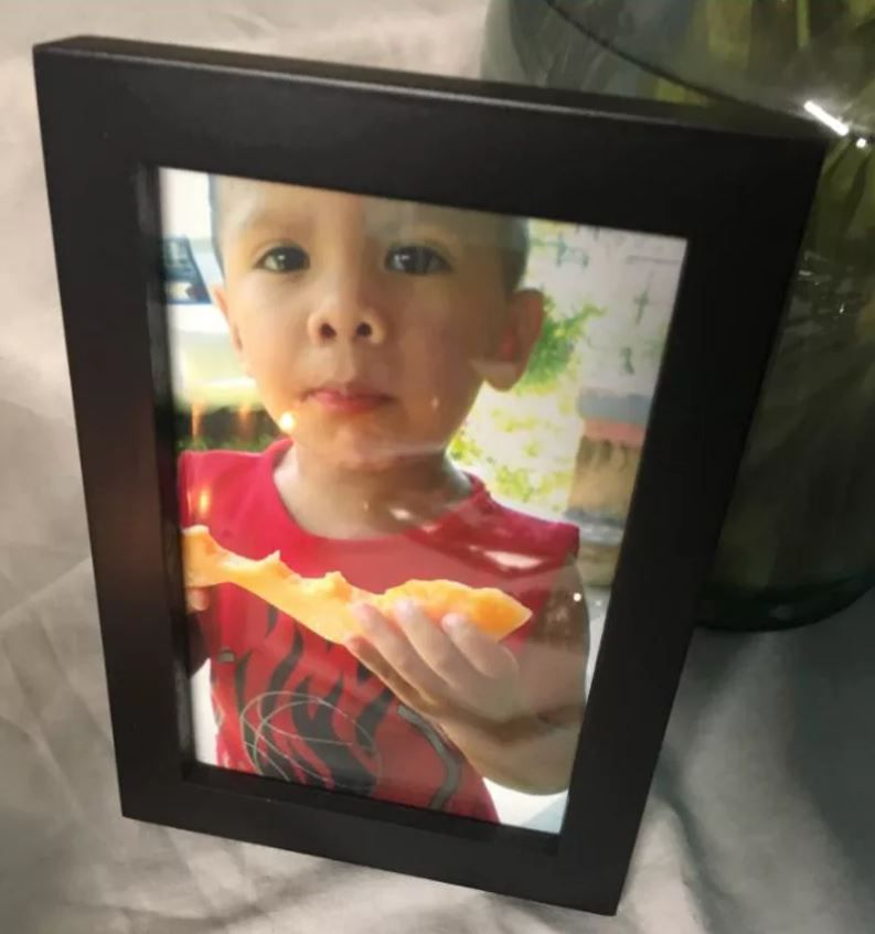 A picture of Darwin Delgado sits on a table at his grandmother's home in Oak Cliff.