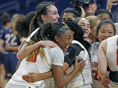 Frisco Liberty guard Jazzy Owens-Barnet #30 joins the rest of the team in celebrating at the end of the game. Frisco Liberty defeated Veterans Memorial 35-26 in a 5A final on Saturday, March 7, 2020 at the Alamodome.