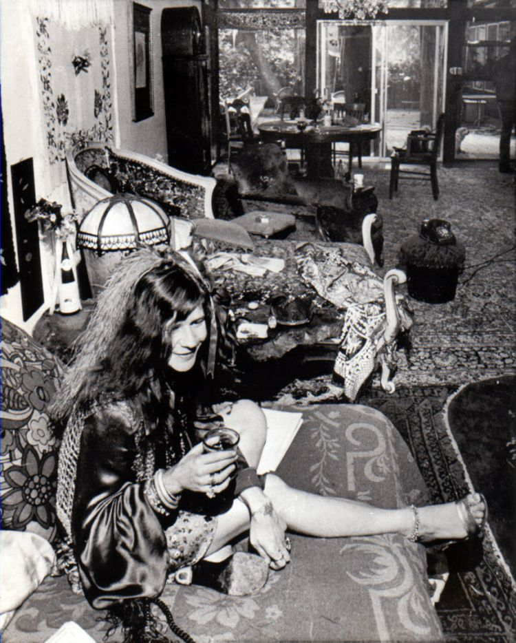 "July 11, 1970  - Janis Joplin, 27-year-old singing superstar, shown here enjoying a drink in her suburban Larkspur home, has come a long way since her rocky childhood in Port Arthur, Texas.  She says: ""I'm going to my 10th high school reunion with bells and feathers, and I'm gonna say, 'Remember me, man -- you laughed me out of class.  What are you doing -- still pumping gas?' ""  Her knockdown brassy style has won her two gold records and fame among devotees of acid rock and blues sounds."