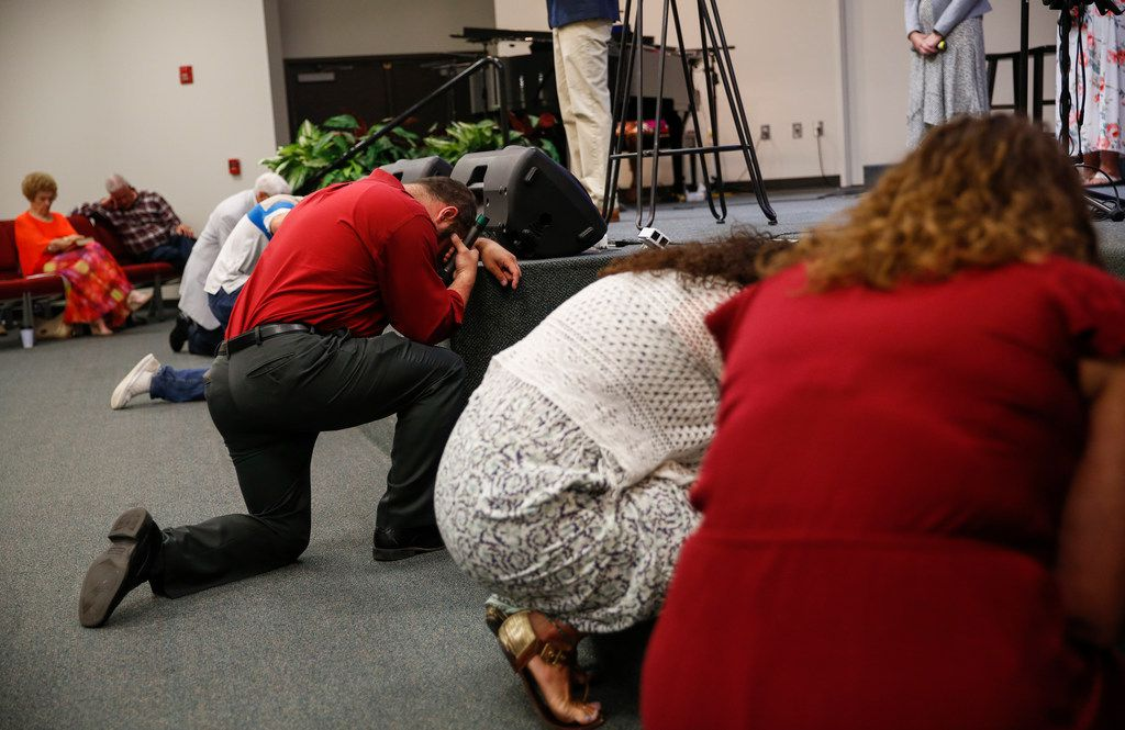 """Church goers gather at Mission Dorado Baptist Church on Sunday, Sept. 1, 2019. The church sits within sight of the movie theater where police took down a gunman who killed at least seven people and shot more than 20 people Saturday. """"This is Odessa, Texas. Things like this don't happen here,"""" said Pastor Del Traffanstedt."""