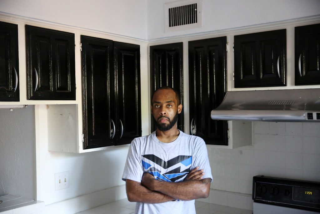 Robin Bobo stands in the kitchen of his Richardson condo, which he was able to afford with the help of a Section 8 housing voucher. He said he painted the cabinets himself before he had to move out this summer.