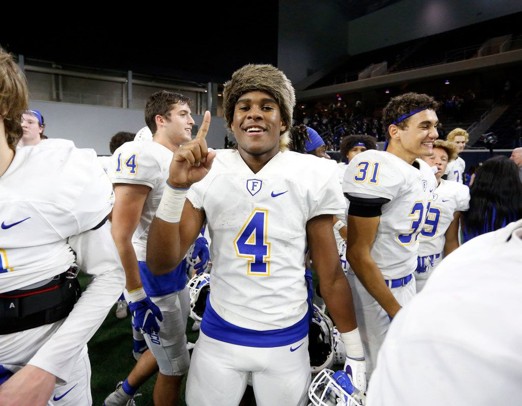 Frisco's Chase Lowery (4), clad in a raccoon skin cap, celebrates his team's 18-0 win over South Oak Cliff in a second-round playoff game at The Star in Frisco on November 22, 2019. Lowery made two interceptions, returning one for a touchdown. (John F. Rhodes/Special Contributor)