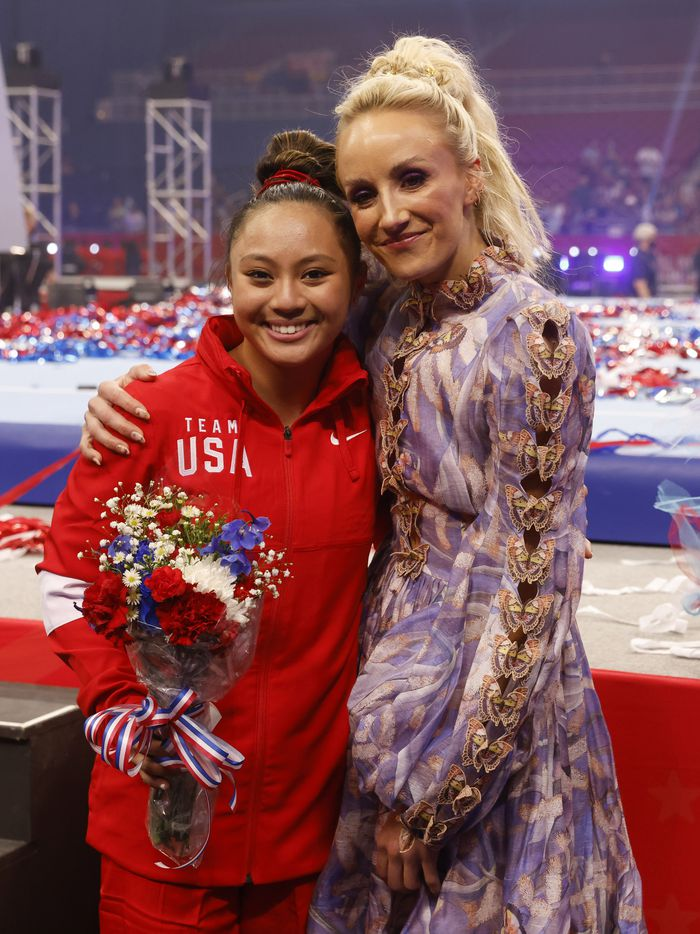 Emma Malabuyo and Nastia Liukin take a hug together after day 2 of the women's 2021 U.S. Olympic Trials at The Dome at America's Center on Sunday, June 27, 2021 in St Louis, Missouri.(Vernon Bryant/The Dallas Morning News)