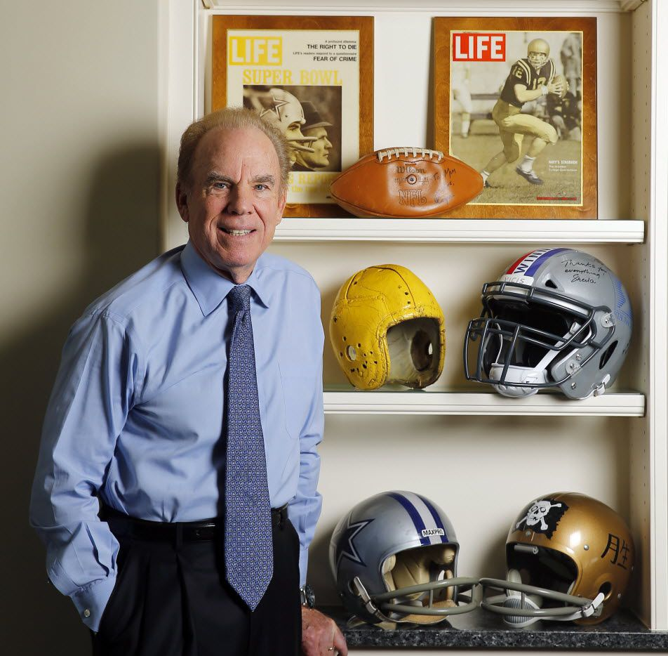 Hall of Fame Dallas Cowboys quarterback Roger Staubach poses with the football helmets that he wore in high school, college and NFL career, at his Dallas home, Friday, July 22, 2016. He wore a leather helmet in high school (yellow) before starting to wear a more traditional helmet at Navy (lower right). He is invested in VICIS, a new football helmet (top right) providing additional protection to the head. (Tom Fox/The Dallas Morning News)