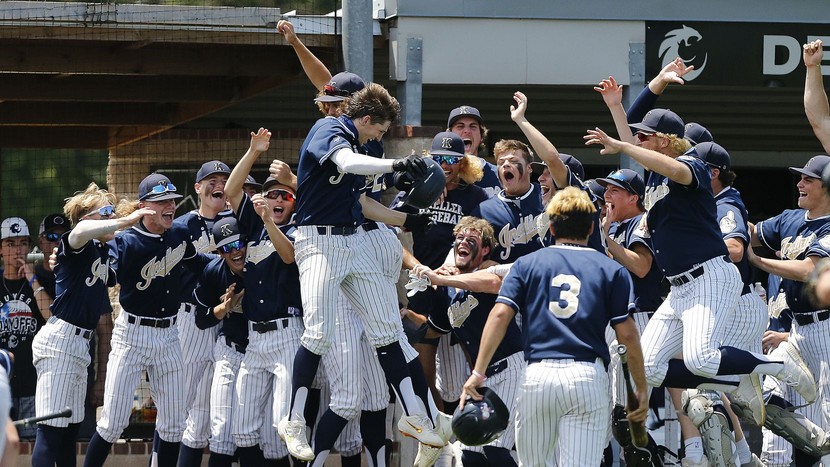 Keller right fielder Clayton Thomas (center) celebrates his home run with the team in the fifth inning as Keller High School hosted Coppell High School in game three of a 6A Region I semifinal series at Denton Guyer High School on Saturday, May 29, 2021.
