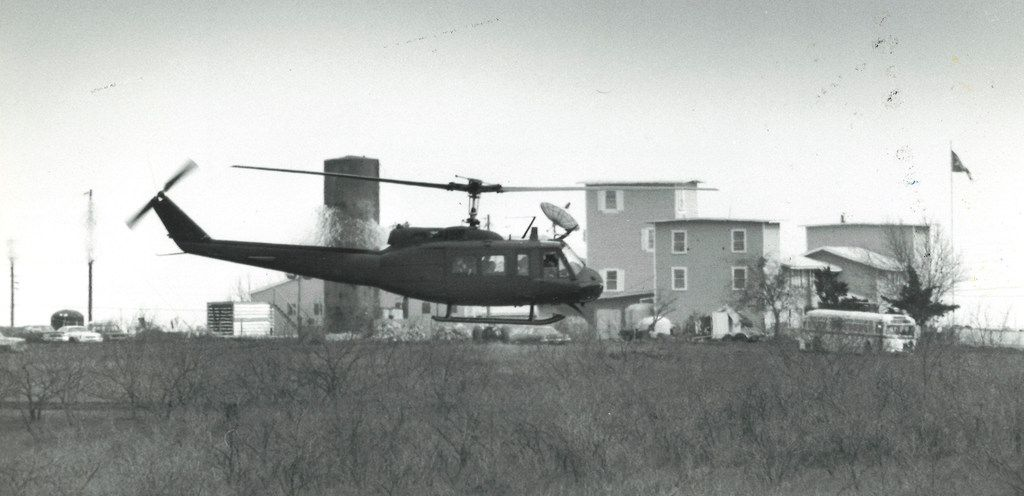 A helicopter flies low around the compound area on March 23. Investigations found that no gunfire came from helicopters during the siege.