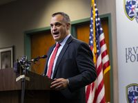 Matthew DeSarno, special agent in charge of the FBI Dallas Field Office, seen speaking at a news conference in August, said Friday that he disputed a statement by former Dallas police Chief U. Reneé Hall regarding the FBI's role in the decision to keep an officer on the job who was suspected in two murder cases.