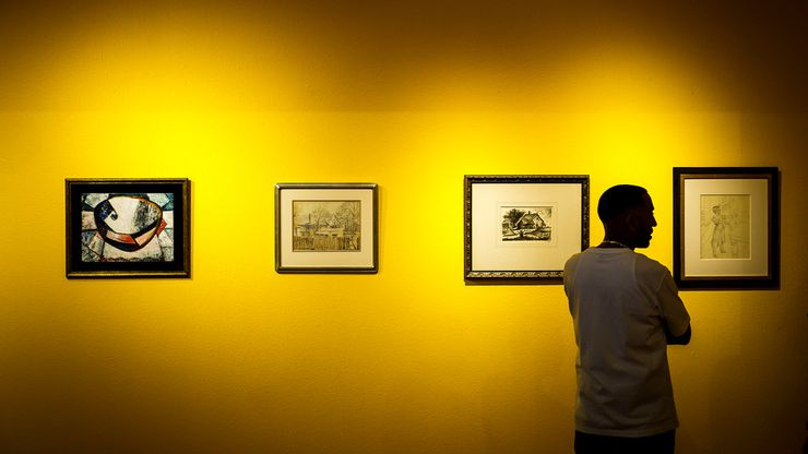 Khalil Kinsey looks over a gallery during the installation of The Kinsey Collection exhibit at the African American Museum on Thursday, Sept. 19, 2019, in Dallas. The exhibit features African-American artwork and historical documents from the Kinsey family's personal collection. (Smiley N. Pool/The Dallas Morning News)