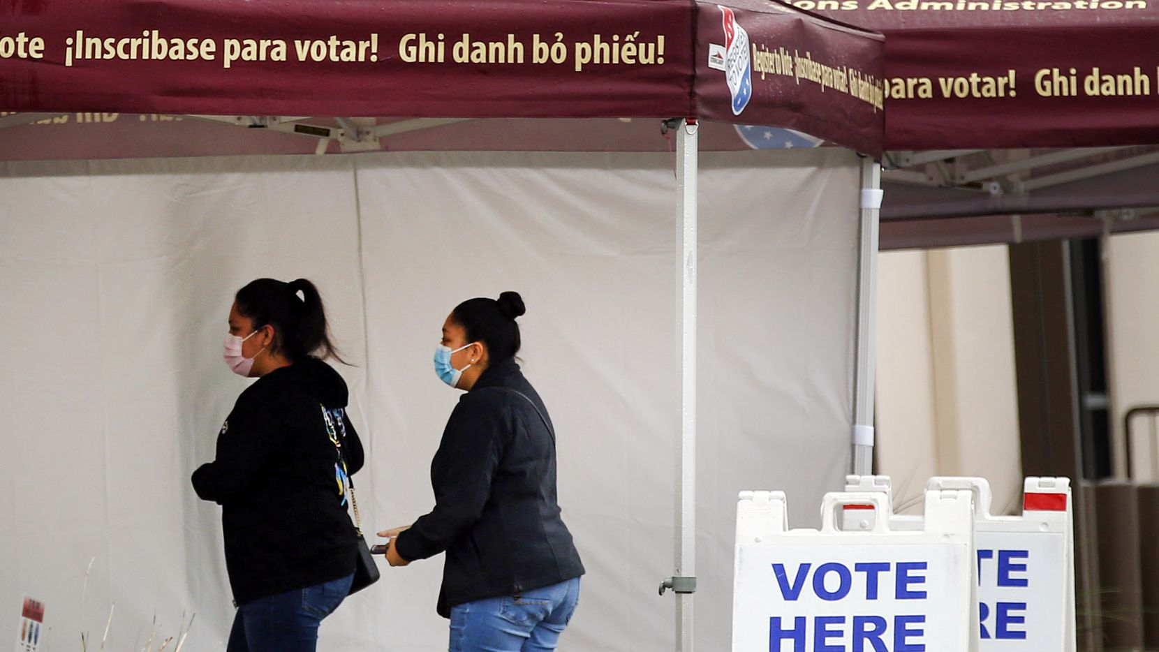 People arrive to the Tarrant County Elections Center to vote early in Fort Worth, Tuesday, October 27, 2020.