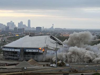 The implosion of Texas Stadium at about the halfway point, seen from the University of Dallas tower.