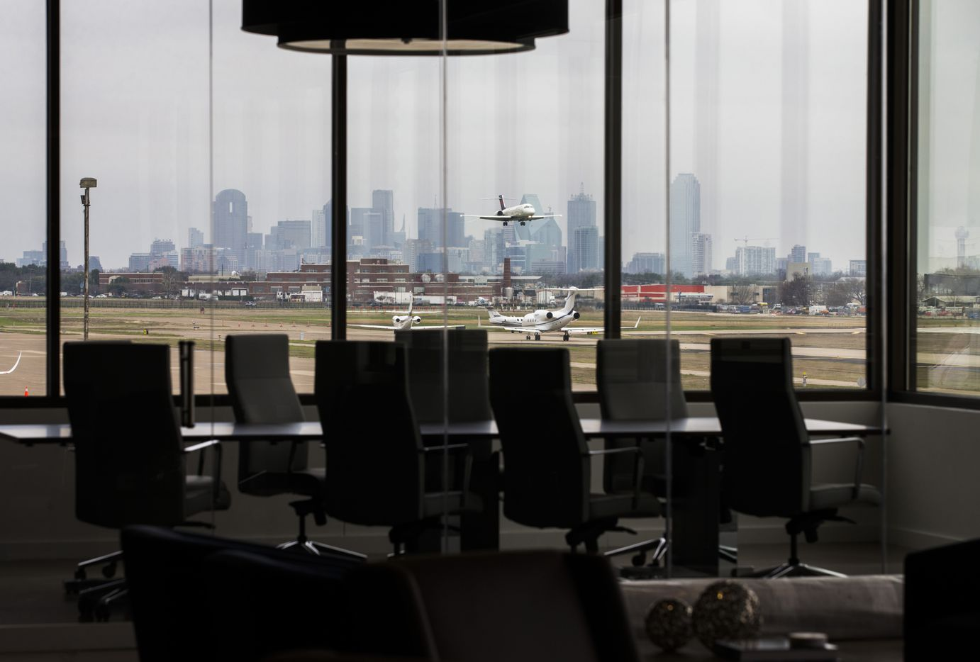 A boardroom that overlooks the runway and the Dallas skyline at Braniff Center on  on Lemmon Avenue in Dallas. (Ashley Landis/The Dallas Morning News)