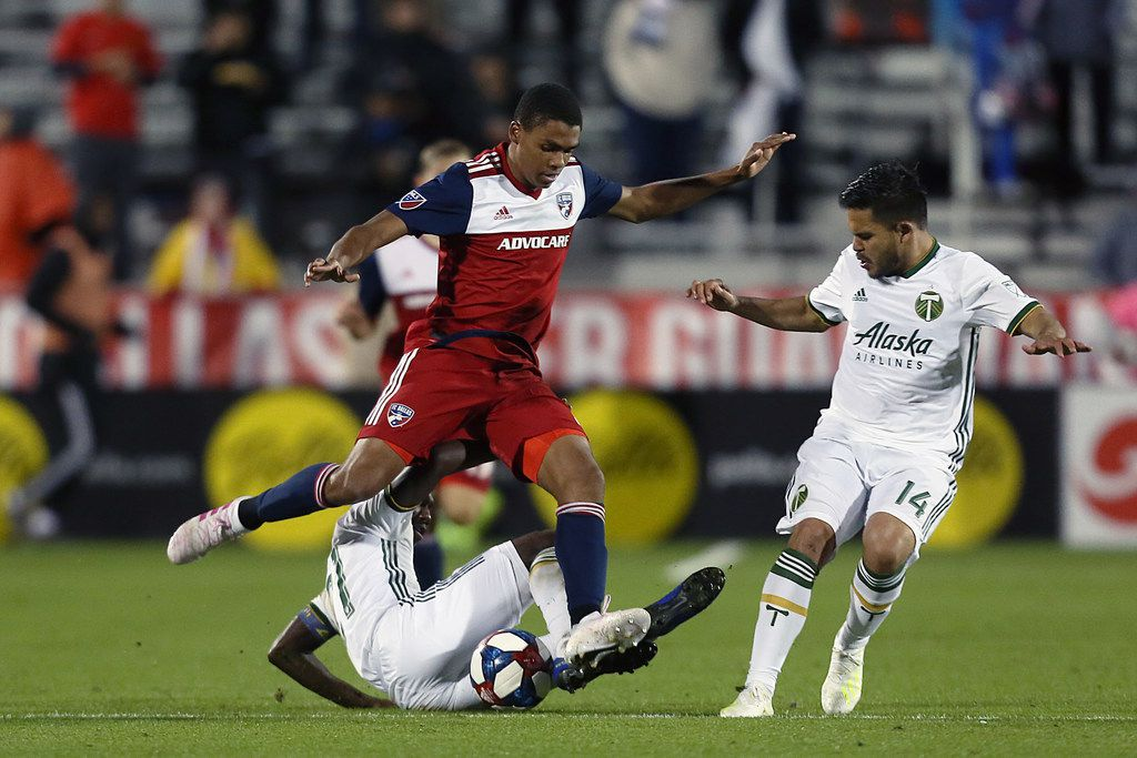 Frisco, Texas: Reggie Cannon #2 of FC Dallas fight the ball during game between FC Dallas and Portland Timbers on April 13, 2019 at Toyota Stadium. (Photo by Omar Vega / Al Dia Dallas)