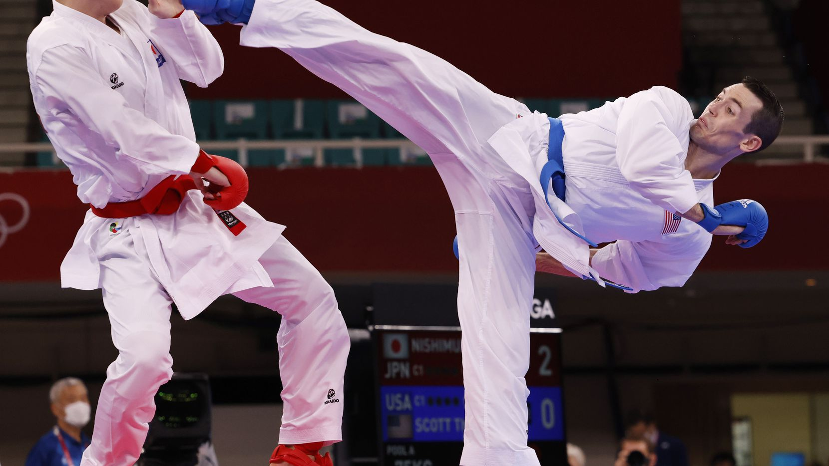 USA's Tom Scott attempts to kick Japan's Ken Nishimura during the karate men's kumite -75kg elimination round at the postponed 2020 Tokyo Olympics at Nippon Budokan, on Friday, August 6, 2021, in Tokyo, Japan. Nishimura defeated Scott 2-0. Scott finished in fourth place in his pool and did not advance to the next round. (Vernon Bryant/The Dallas Morning News)