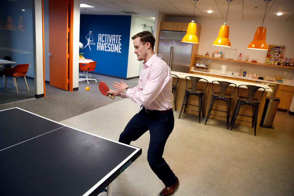 Franchisee operations manager Jeff Bales plays table tennis at the headquarters in Bedford. He and co-worker Michael Calloway play at least a couple of times a day.