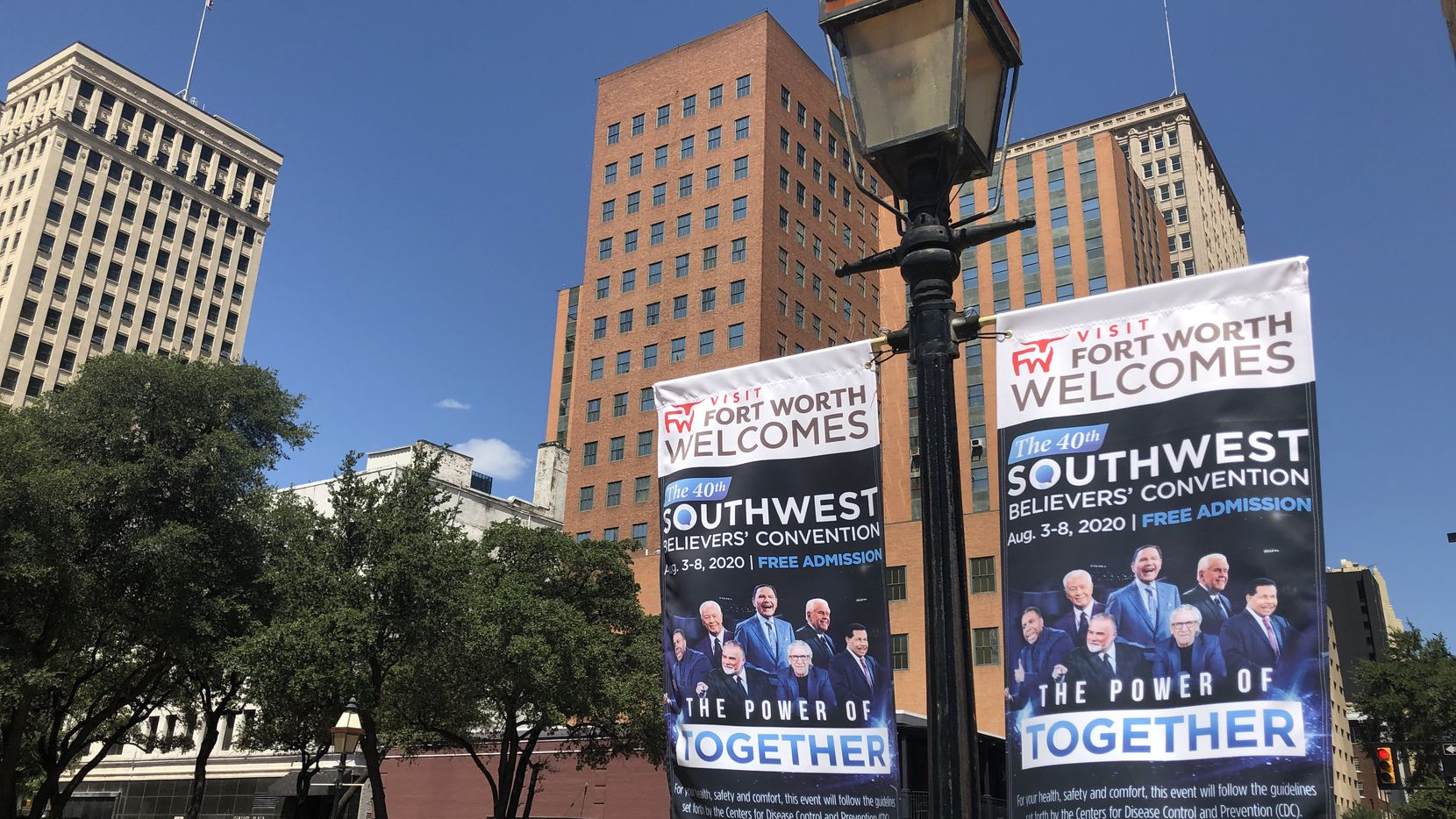 Banners for Kenneth Copeland's religious revival hang on Fort Worth streets. The event was Aug. 3-8, 2020 during the pandemic.