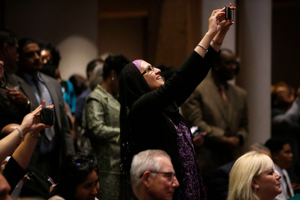 "Zulikha Hussain takes a photo during a meeting at the Dallas County Commissioners Court in Dallas on Tuesday, Feb. 7, 2017. More than a dozen D-FW advocacy groups gathered in support of a ""Welcoming Communities"""" resolution, which serves as a proclamation to all residents that Dallas County supports immigrant, refugee, and marginalized communities, documented and undocumented, and values them as integral members of our community.  (Rose Baca/The Dallas Morning News)"