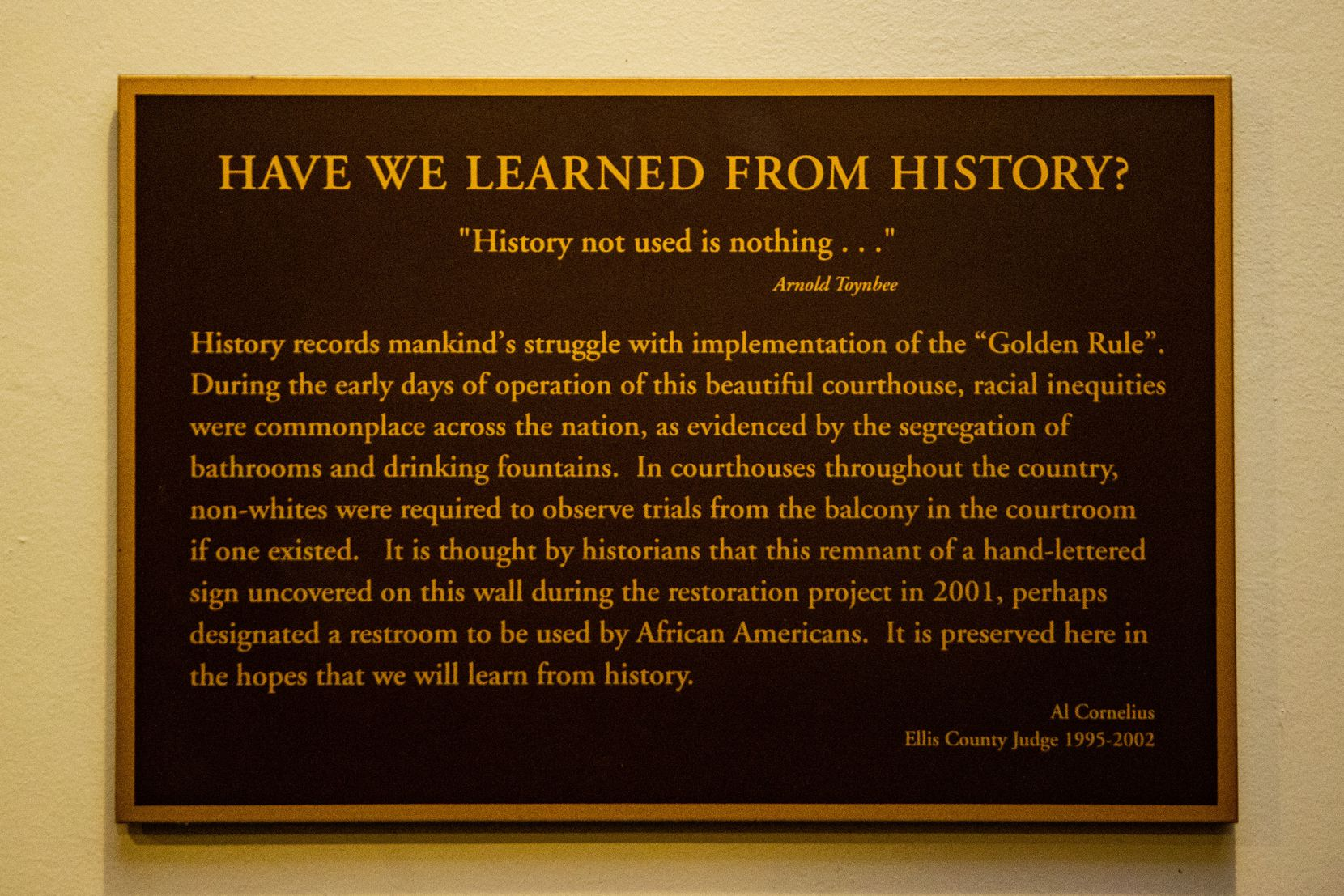 """A historical marker placed under a sign that reads """"NEGROES"""" is at the Ellis County Courthouse in Waxahachie."""