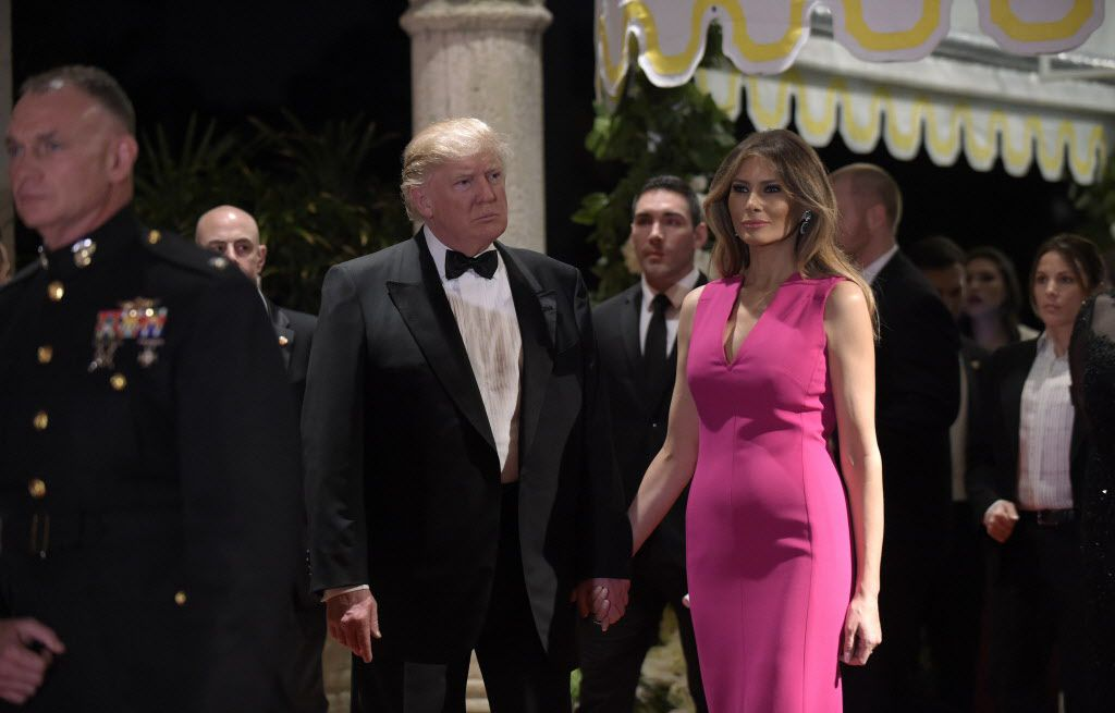President Donald Trump and first lady Melania Trump arrived for the 60th annual Red Cross Gala at Trump's Mar-a-Lago resort in Palm Beach, Fla., on Saturday. (Susan Walsh/The Associated Press)