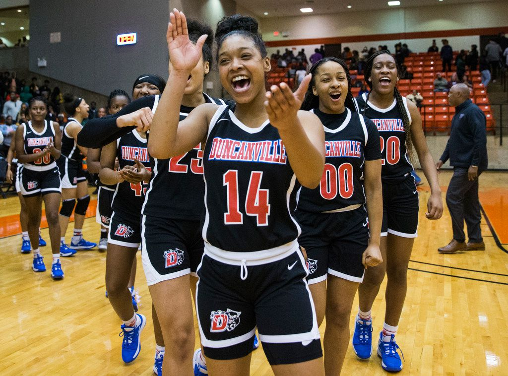 Duncanville's Kiyara Howard (14) and the rest of the team celebrates a 47-43 win after a Class 6A Region I quarterfinal girls basketball game between Duncanville and DeSoto on Tuesday, February 25, 2020 at Wilkerson-Greines Activity Center in Fort Worth. (Ashley Landis/The Dallas Morning News)