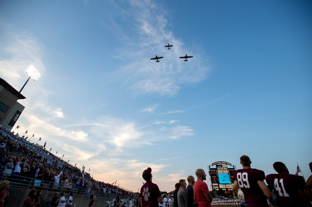 Two T-6 airplanes and an RV-8 airplane perform a flyover before a high school football game between Plano and Rowlett on Friday, September 15, 2017 at John Clark Field in Plano, Texas. (Jeffrey McWhorter/Special Contributor)