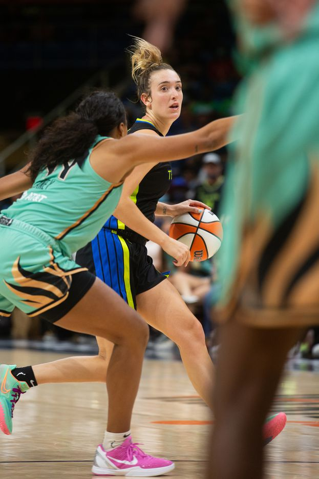Dallas Wings guard Marina Mabrey (3) dribbles the ball down the court during their game against NY Liberty at College Park Center in Arlington, TX on September 11, 2021.  (Shelby Tauber/Special Contributor)