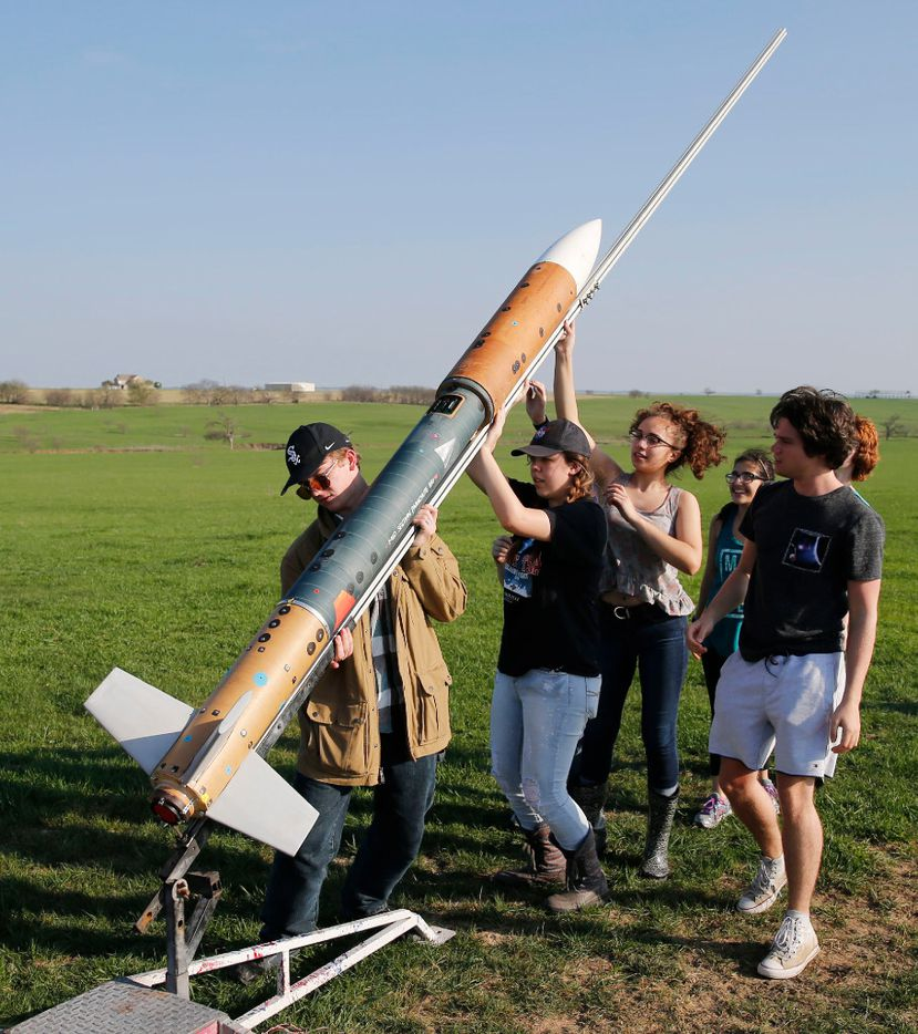 The McKinney High School Flying Lions Rocketry Team works on putting the rocket on its launchpad in Gunter on Saturday. (Vernon Bryant/The Dallas Morning News)