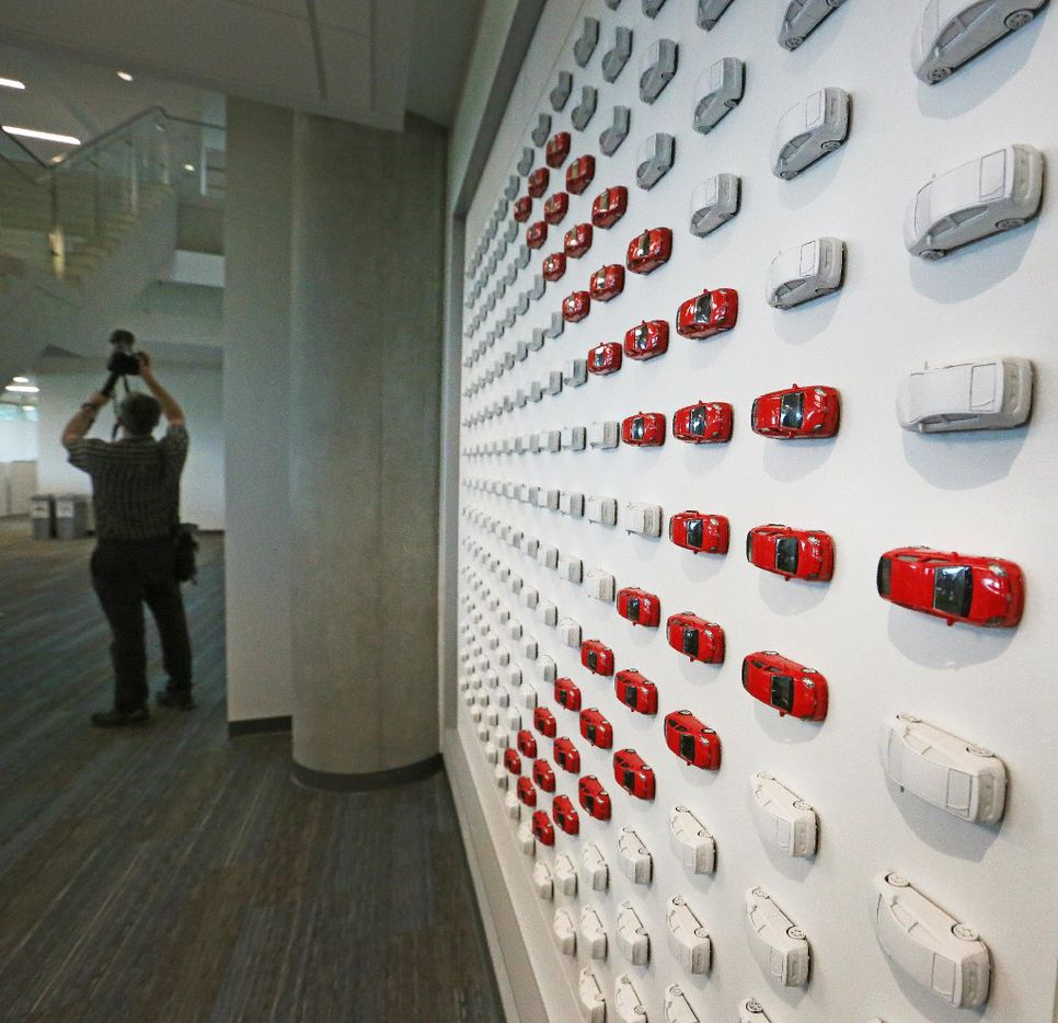 Miniature Camrys are part of a piece of artwork on the walls of the workspace, as seen at the grand opening of the Toyota headquarters in Plano, Texas, photographed on Thursday, July 6, 2017. (Louis DeLuca/The Dallas Morning News)