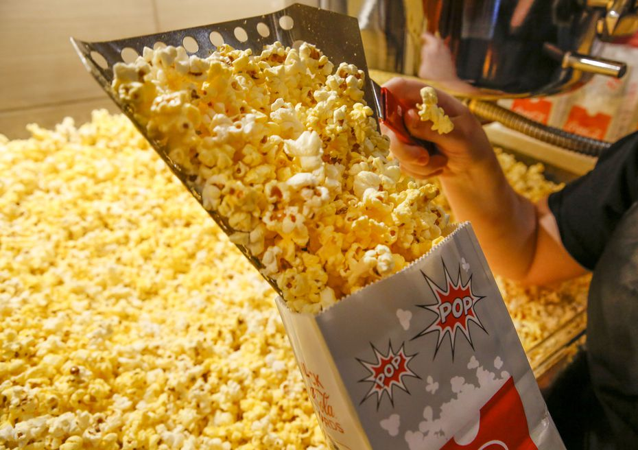 A crew member bagged popcorn at a Cinemark theater at the corner of Coit Road and Park in Plano last year.