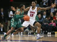 South Florida Bulls guard LaQuincy Rideau (3) drives past Southern Methodist Mustangs forward Isiaha Mike (15) during the second half of a matchup between the Southern Methodist Mustangs and the South Florida Bulls on Thursday, Feb. 7, 2019 at Moody Coliseum in Dallas. (Ryan Michalesko/The Dallas Morning News)