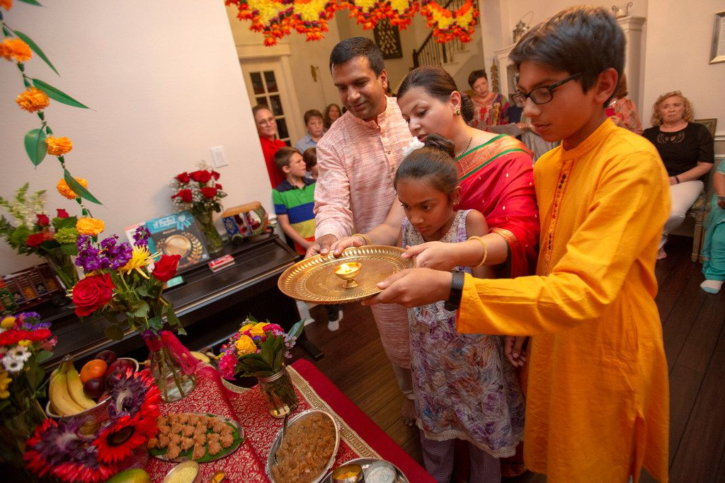 Hosts Sapna Punjabi-Gupta and husband Saurabh Gupta join son Aditya, 13, and daughter Mihika, 9, during a Ganesha Chaturthi celebration and dinner in Irving.