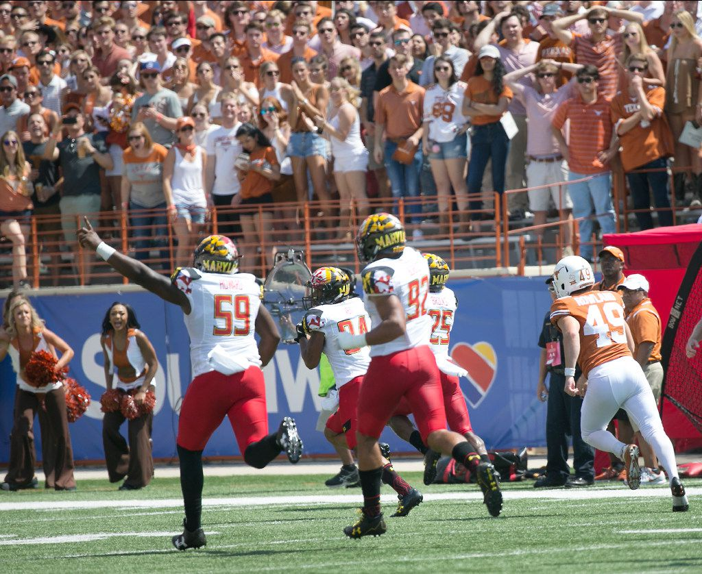 Maryland's Jacquie Veii returns a blocked field goal for a touchdown in second-quarter action as Texas kicker Joshua Rowland (45) can only watch at Darrell K. Royal Memorial Stadium in Austin, Texas, on Saturday, Sept. 2, 2017. Maryland won, 51-41. (Ralph Barrera/Austin American-Statesman/TNS)