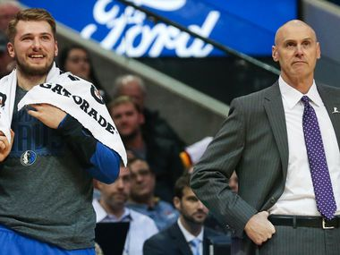 Dallas Mavericks forward Luka Doncic (77) and Dallas Mavericks head coach Rick Carlisle stand on the sideline during the first half of a matchup between the Dallas Mavericks and the Houston Rockets on Sunday, March 10, 2019 at the American Airlines Center in Dallas.