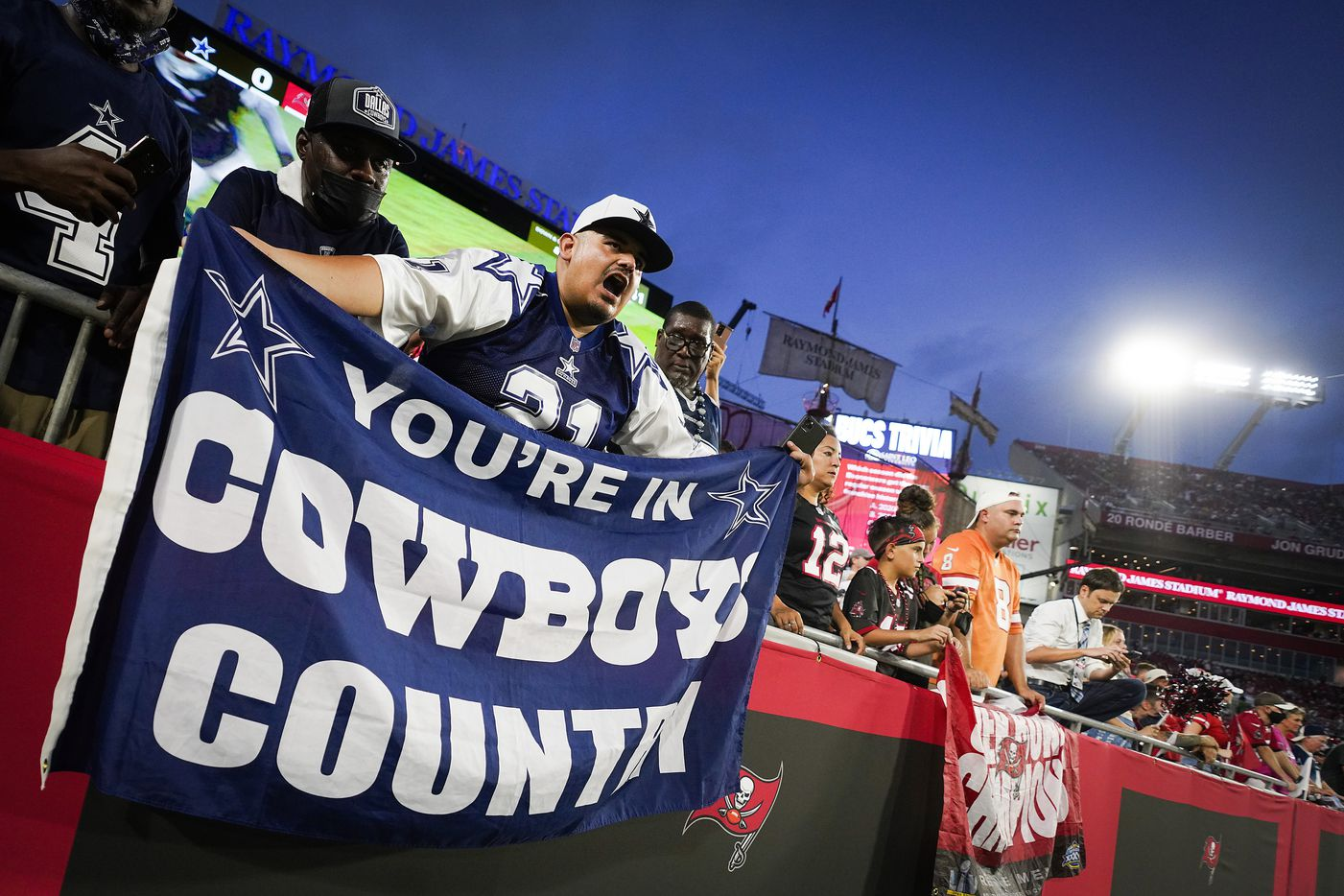 Dallas Cowboys fans cheer their team before an NFL football game against the Tampa Bay Buccaneers at Raymond James Stadium on Thursday, Sept. 9, 2021, in Tampa, Fla. (Smiley N. Pool/The Dallas Morning News)