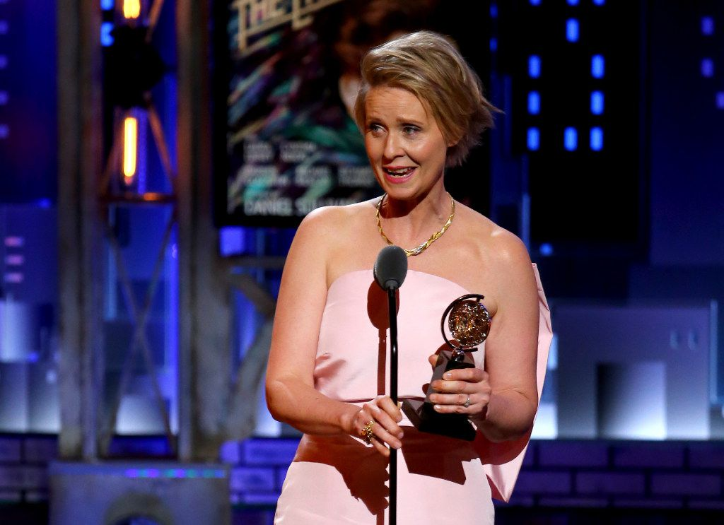 """Cynthia Nixon accepts the award for best performance by an actress in a featured role in a play for """"Lillian Hellman's The Little Foxes"""" at the 71st annual Tony Awards on Sunday, June 11, 2017, in New York. (Photo by Michael Zorn/Invision/AP)"""