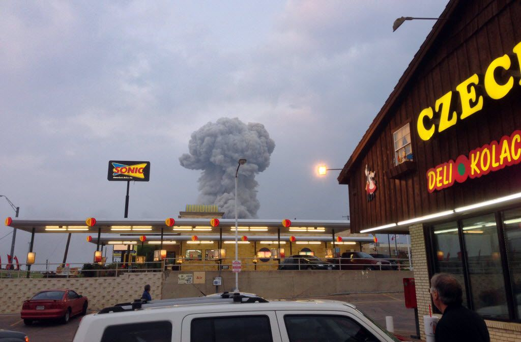 People at the Czech Stop watched the cloud of smoke rising from the explosion at the fertilizer plant in West on April 17, 2013.