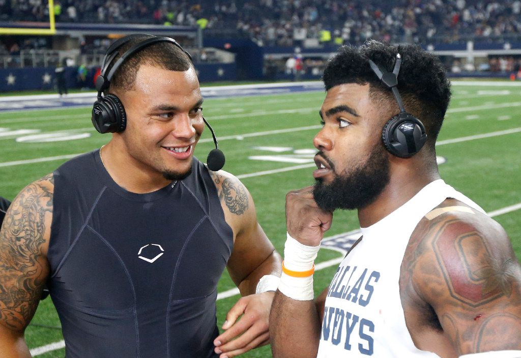 FILE - In this Nov. 24, 2016, file photo, Dallas Cowboys quarterback Dak Prescott (4) smiles as he and running back Ezekiel Elliott, right, participate in a post game interview after an NFL football game against the Washington Redskins,  in Arlington, Texas. Hall of Fame general manager Bill Polian says it takes a good five years to judge a draft class but even he can appreciate the quick impact that Ezekiel Elliott and Dak Prescott have had with the Dallas Cowboys. Polian said he can't remember a rookie duo that has had an impact on a team as both are likely to finish 1-2 in Offensive Rookie of the Year voting. (AP Photo/Michael Ainsworth, File)