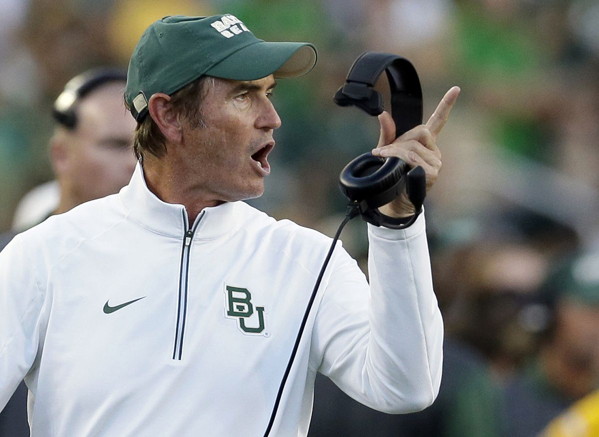 Baylor coach Art Briles yells from the sideline during the first half of an NCAA college football game against Lamar in Waco, Texas. Baylor University's board of regents says it will fire Briles and re-assign university President Kenneth Starr in response to questions about its handling of sexual assault complaints against players.