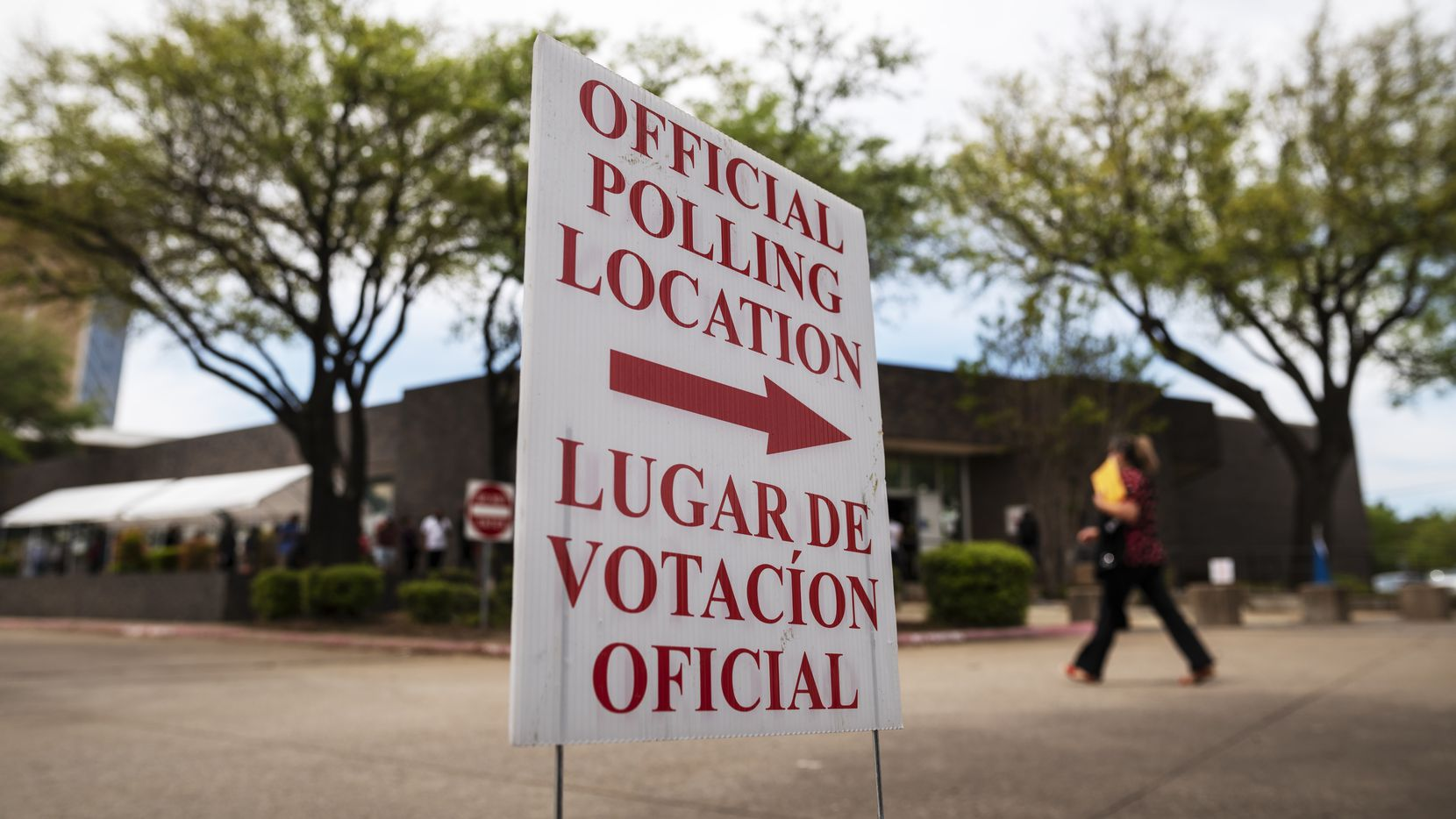 Signs marking an official polling location outside of the Oak Cliff Sub-Courthouse in Dallas during the first day of early voting, on Monday, April 19, 2021.