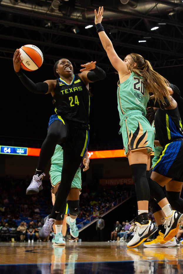 Dallas Wings guard Arike Ogunbowale (24) pushes through the NY Liberty defense of NY Liberty's Sabrina Ionescu (20) at College Park Center in Arlington, TX on September 11, 2021.  (Shelby Tauber/Special Contributor)