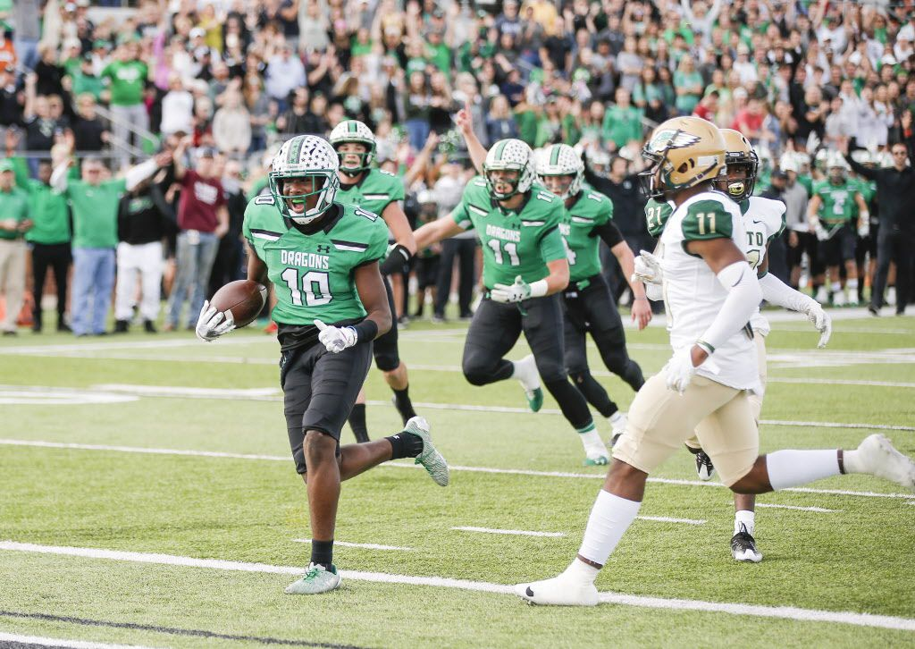 TXHSFB Southlake Carroll junior defensive back RJ Mickens (10) scores a touchdown as DeSoto senior defensive back Kenneth Salter (11) defends during the first half of a Class 6A Division I area-round playoff high school football game at Newsom Stadium in Mansfield, Saturday, November 24, 2018. (Brandon Wade/Special Contributor)