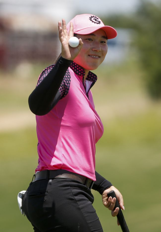 Professional golfer Min-G Kim waves to the crowd after making par on the 18th hole during round one of the LPGA VOA Classic on Thursday, July 1, 2021, in The Colony, Texas. Kim finished the first day at six under par. (Elias Valverde II/The Dallas Morning News)