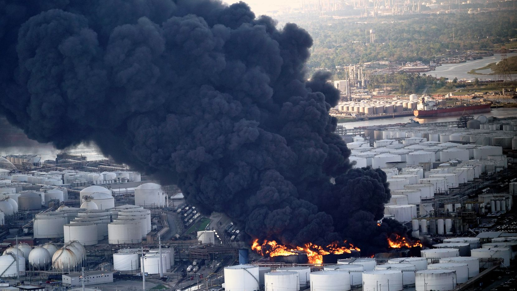 A plume of smoke rises from a petrochemical fire at the Intercontinental Terminals Co. on March 18 in Deer Park.
