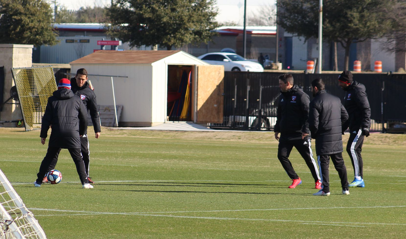 January 26, 2019 (Frisco, TX): FC Dallas coaches (L-R) Luchi Gonzalez (back to shot, wearing a hat), Mikey Varas, Eric Quill, Skylar Richards, and Peter Luccin take part in a rondo passing drill as the FC Dallas players warm up at Toyota Soccer Center.