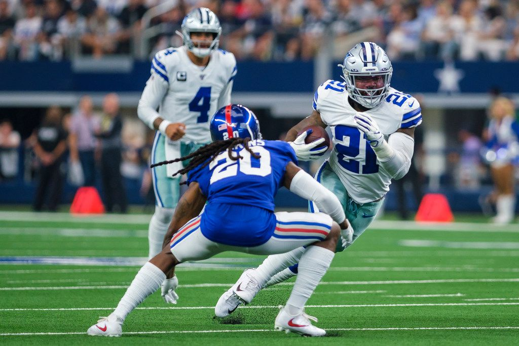 Dallas Cowboys running back Ezekiel Elliott (21) tries to get past New York Giants cornerback Janoris Jenkins (20) during the second half of an NFL football game at AT&T Stadium on Sunday, Sept. 8, 2019, in Arlington, Texas.