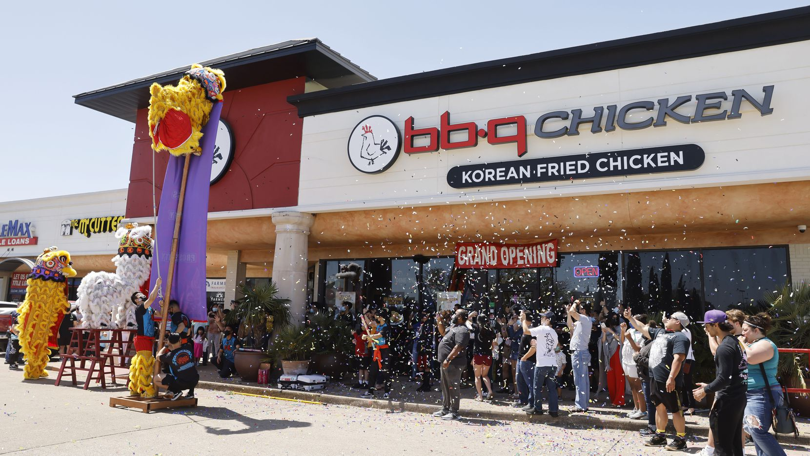 Confetti flies through the air during a grand opening event at BB.Q Chicken in Richardson.