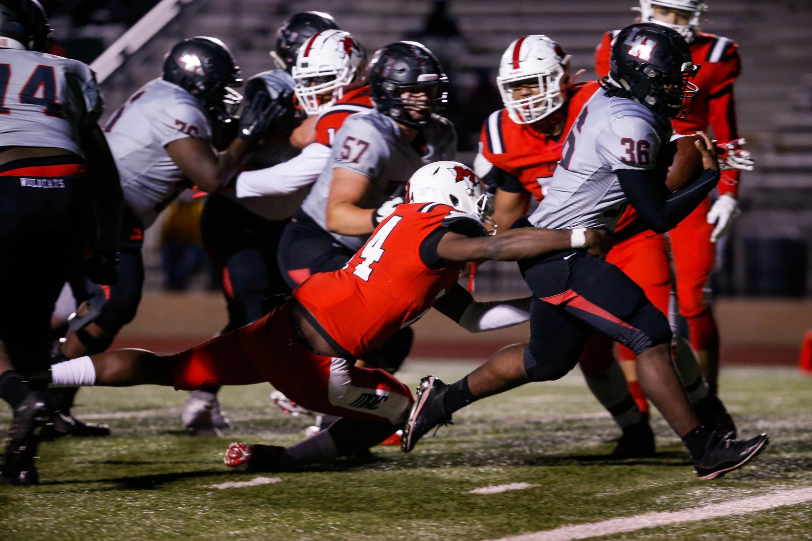 Lake Highlands quarterback Zhmari Edwards (36)evades the Irving MacArthur defense for a touchdown during the fourth quarter of a high school football game at Joy & Ralph Ellis Stadium in Irving on Friday, Oct. 23, 2020. (Juan Figueroa/ The Dallas Morning News)