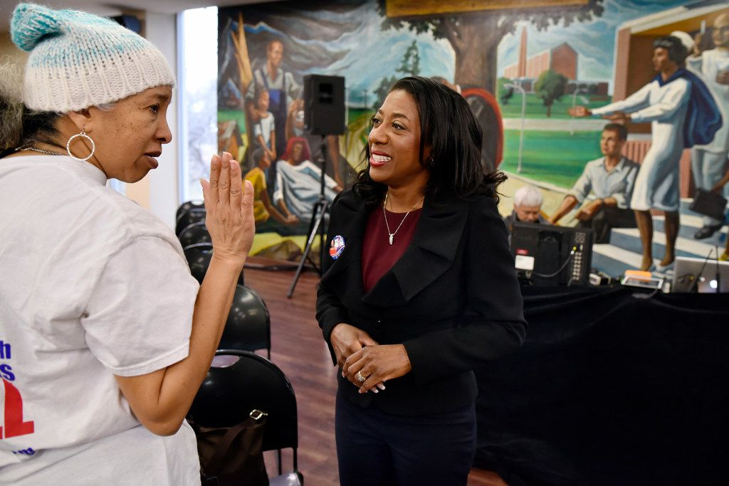 Elizabeth Frizell, democratic candidate for Dallas county district attorney, meets with supporter Kim White before a criminal justice forum at Paul Quinn College in Dallas.