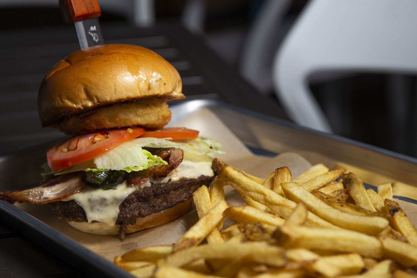 The Lonestar burger from Mudhook comes with the spicy addition of jalapenos. Mudhook's sandwich buns come from Village Baking Co., a company in Dallas.