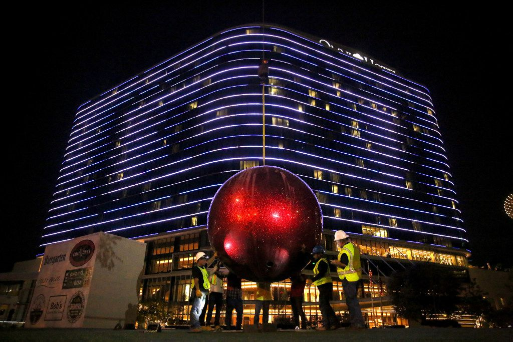 Workers installed a giant red Christmas ornament outside the front lawn of the Omni Dallas Hotel late Tuesday evening on Nov. 15.