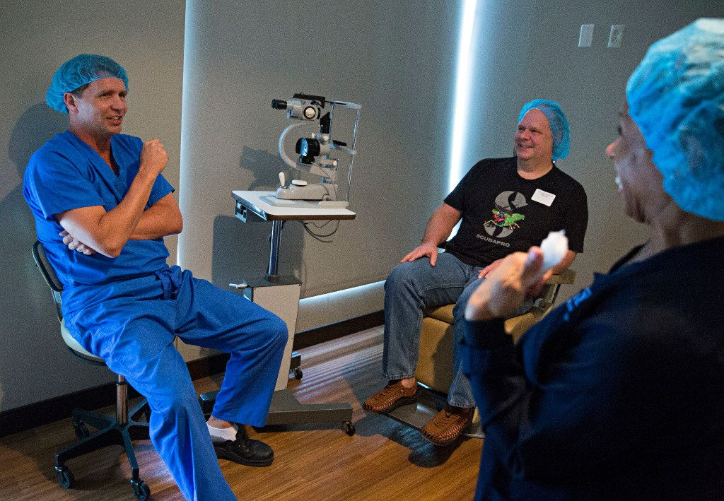 Dr. Brad Bowman (left), a surgeon at Cornea Associates of Texas, jokes with patient Ted Kearn and ophthalmic technician Carline Murat before Kearn's lasik surgery in September.